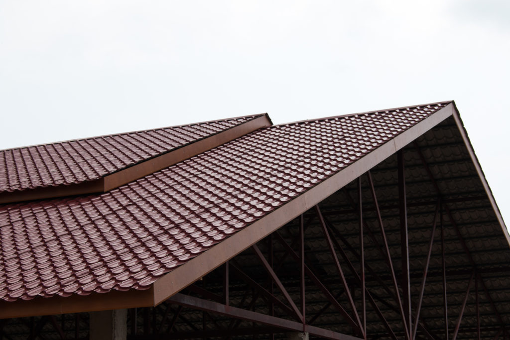 a tiled roof with metal braces