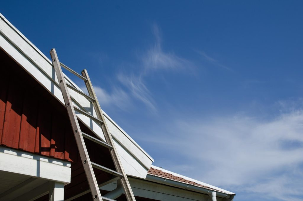 a metal ladder leaning on the roof
